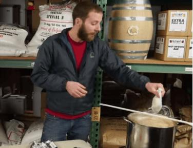 man adding hops in muslin bag