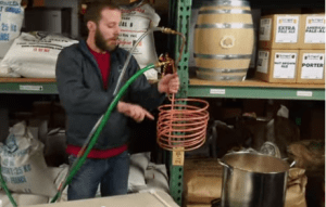 man using wort chiller