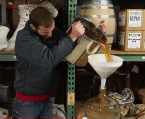 man pouring wort into fermenter