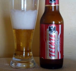 Tecate glass and bottle