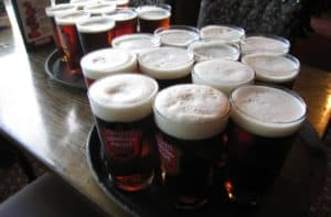 dozen glasses of London Pride Beer