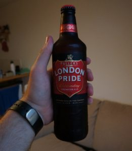 man holding a beer bottle of london pride